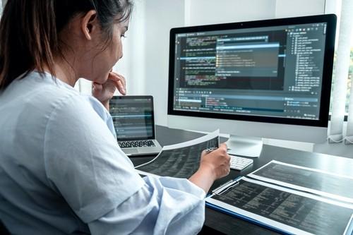 Female,Developer,Programmer,Working,On,Coding,Program,Software,Computer,,Writing